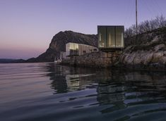 This boutique hotel on the remote Manshausen Island in northern Norway is made up of four sea cabins which all feature stunning panoramic views over the surrounding islands and the Lofoten mountains to the north. Lofoten, Eco Cabin, Timber Cabin, Hotel Aurora Boreal, Design Hotel, House Design, Bergen, High Design, Norway Design