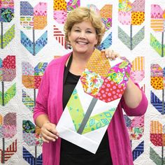 Watch, as Jenny teaches this fun way to create a super sweet Totally Tulip Quilt!