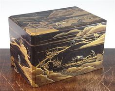 A Japanese lacquer and mixed metal overlaid tea caddy, Meiji period, the exterior decorated in gold lacquer with river landscape scenes applied in shakudo, gilt bronze and silver with figures of farmers in the fields including an oxen pulling a plough, the interior containing a pair of 'mack' decorated canisters with sliding lids, 24.5cm, repair to cover
