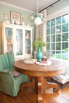 Cozy dining room painted in benjamin moore's prescott green. I need a spot like this!