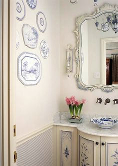Love this Powder Room. Look at the chandelier in the mirror. Perfect!