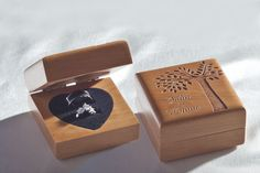 custom engraved wood wedding ring box for a rustic wedding with a tree design