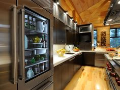 HGTV 2011 Dream Home Kitchen- love the glass door fridge but I guess I would have to make sure everything in their was neat and tidy!