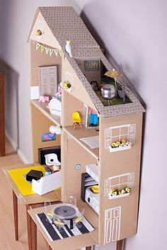 Cardboard dollhouse - all those details!! The tea strainer grill! The window boxes!