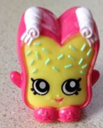 Fairy Crumbs (Shopkins 1-088, 1-098) Fairy Crumbs is a brown slice of fairy bread with green sprinkles.On her head she has two rolls of butter. Her variant is a pink slice of fairy bread with white sprinkles and butter.  Fairy Crumbs is a common Party Food Shopkin from Season One.