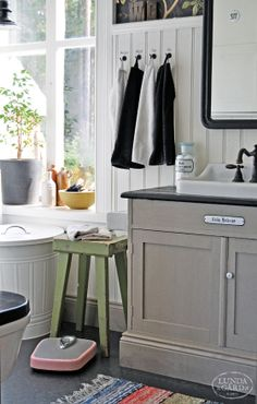 white walls with dark floor and browny-grey cabinets.  countertop and faucet colors go well with it too