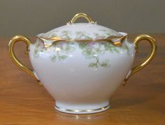 Lovely covered sugar bowl with gold gilt.