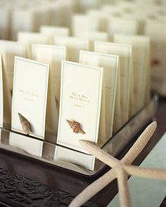 Placecards embellished with tiny seashells is a great touch for a beach wedding.