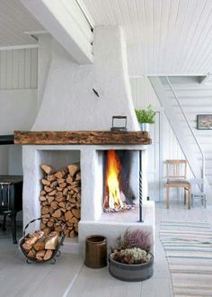Wood storage in fireplace. Clean and white. Would be nice outside. Love what the fireplace is made out of. Decoration Inspiration, Interior Inspiration, Decor Ideas, Home Decoration, Wall Ideas, Design Inspiration, Scandinavian Fireplace, Scandinavian Style, Scandinavian Cottage