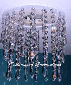 My recessed lighting trim brings you chandelier magnificence with genuine leaded crystal flowing from a high-gloss white finish. 52 chains of 30% leaded crystal put together by hand with glamorous Asfour crystal make up this beautiful addition to your home.    $249.00