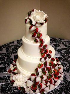 White chocolate cake with chocolate strawberries