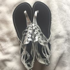 Love Culture Silver Gladiator Sandals Worn but in good condition. Some fraying on the straps as seen in the picture but the bottoms are new Love Culture Shoes Sandals