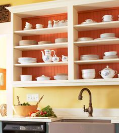 I never thought about having open cabinets in the kitchen but the idea looks pretty good =D I hate hitting my head on the cabinet doors, plus I like looking at the organized plates, etc... =)