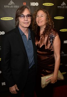 Jackson Browne Photos - Musician Jackson Browne (R) and Dianna Cohen arrive at the 28th Annual Rock and Roll Hall of Fame Induction Ceremony at Nokia Theatre L.A. Live on April 18, 2013 in Los Angeles, California. - Arrivals at the Rock and Roll Induction Ceremony