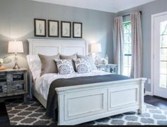 gray and white bedroom. The newly redesigned master bedroom has dark wood floors  large windows and French doors linen drapes blue gray walls Gorgeous Gray White Bedrooms Master