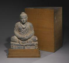 A GANDHARAN SCHIST FIGURE OF A SEATED BUDDHA 2ND / 3RD CENTURY