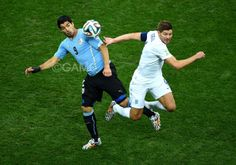 - #LuisSuarez of #Uruguay competes for the ball against #StevenGerrard of #England during the 2014 #FIFAWorldCup Brazil Group D match between Uruguay and England at Arena de Sao Paulo on June 19, 2014 in Sao Paulo, #Brazil.
