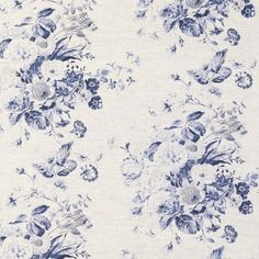 Constance Linen Fabric A beautiful linen fabric with faded floral design printed in shades of blue on a natural ground.