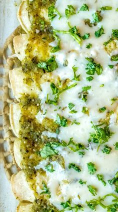 Enchiladas with Creamy Green Sauce (Enchiladas Suizas) - Add a bit of cream to a traditional green sauce and you've got everything you need to make mouth-watering Enchiladas Suizas. This recipe also uses a roasted poblano to enhance the flavor. So good! mexicanplease.com