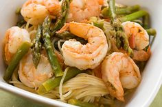 Angel Hair with Shrimp & Asparagus End your Friday on a light note with Skinnytaste's angel haired pasta paired with succulent shrimp and asparagus. This recipe calls for a light tomato broth which goes well with our mild mannered s...