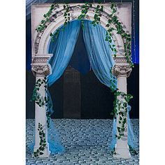 This Romance in Rome Archway is a Roman masterpiece accented with Pathos garland and tulle. Each Roman Archway is made of Photo Real cardboard.
