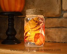So on your next walk collect some beautiful autumn leaves.  Bring them in and dry them between sheets of newspapers for about two weeks or more.  After that, they can be decoupaged on to a recycled glass jar (I used a pasta jar).  When you place a votive candle inside, the light shines through the leaves, creating a beautiful effect.