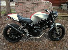 More ideas: powdercoated black frame, with ducati-like seat. Requires a complete overhaul of the rear end.