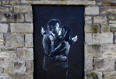 Phone Lovers - Street Art by Banksy in Bristol