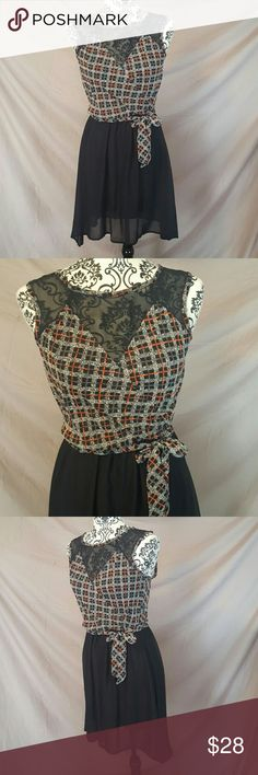 """Plaid Print Wrap High Low Dress Brand new boutique dress (does not come with tags)! Size Small. The top is a light, chiffon type material with plaid print. Faux wrap style bust with sheer black on the top. Waist tie. The skirt is lined black with high low style. Very cute!  Measurements ( laying flat, unstretched): Bust-17"""" Waist-13"""" Length-35"""" from shoulder to front hemline D'Enjoy Dresses High Low"""