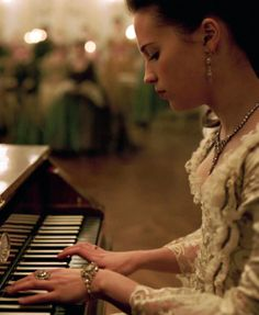 """""""Isn't the music beautiful?""""     She smiled softly as her fingers danced across the keys. """"The piano was always my favorite. It was my escape. Whenever I played, I could disappear into another world. This world."""""""