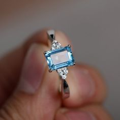 Items similar to Swiss Blue Topaz Ring Promise Ring Engagement Ring Blue Topaz Gemstone Stelring Silver Ring on Etsy Blue Topaz Ring, Topaz Gemstone, Gemstone Rings, Green Sapphire, Square Diamond Rings, Diamond Stone, Silver Gifts, Ring Verlobung, Solitaire Ring