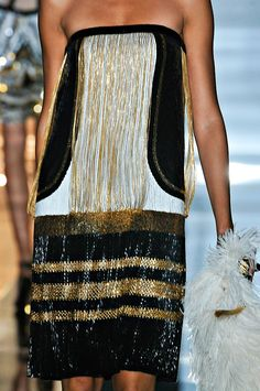 Gucci... I don't care who makes it, I'm just loving the gold glitz to it!