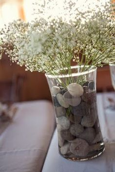 Baby's Breath centerpieces with river rocks.