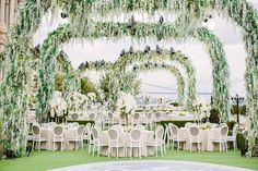 Why settle for one #floral arch when you can have multiple? We can dream, can't we? Massive white #wisteria coated installations framed this outdoor #wedding at Küçüksu Palace in #Istanbul, #Turkey planned by @rafanellievents. We can only imagine how much work went into creating this visionary setup! Repost: @rafanellievents | WedLuxe Magazine | #luxury #wedding #weddinginspiration #decor