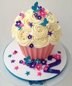 Flower_Butterfly_Cupcake, spring garden, blue butterfulies, white buttercream frosting, cupcakes, dessert, food, cupcake, pink flower, pink cupcakes