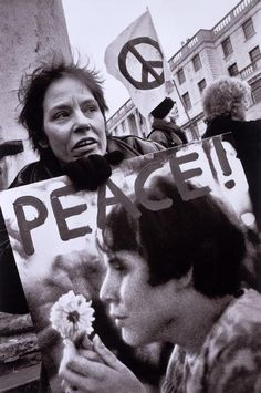 Marc RiboudENGLAND. London. Anti-war protest through the streets. Jan Rose Kasmir was photographed by Marc Riboud in 1967 during the anti Vietnam demonstration at the Pentagon, Washington, USA. That demonstration helped turn the tide of public opinion against the war. She is seen here holding the photograph from 1967. The number of marchers was estimated between 750,000 to 2,000,000. February 15TH, 2003.