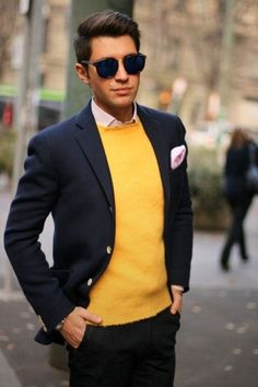 Perfect the smart casual look in a dark blue wool blazer and black chinos. Shop this look on Lookastic: https://lookastic.com/men/looks/blazer-crew-neck-sweater-dress-shirt-chinos-pocket-square-sunglasses/4280 — Navy Sunglasses — Pink Dress Shirt — Pink Pocket Square — Yellow Crew-neck Sweater — Navy Wool Blazer — Black Chinos