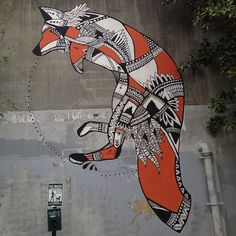 The fox was painted in Cabbagetown, a small neighborhood east of Atlanta, GA, and it was a collaboration between Trek Matthews and Living Walls Concepts, which aims to highlight up-and-coming artists through street art.