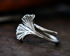 This lovely ginkgo leaf wrap ring is made of full oxidized sterling silver. Very well polished and looks beautiful on your finger. US Size Available: 5-9, and any size in the middle is OK.  This is a wrap ring, and can be adjusted a little bit to fit your finger size. Website:http://hongxistudio.com/