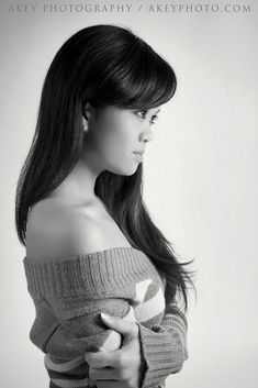 Profile portrait of a beautiful young Asian woman.