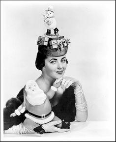 1952, Elaine Johannsen wearing a millinery masterwork created by Mr John of New York