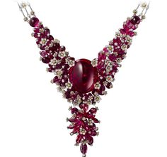 Cartier. Necklace - white gold, one 62.15-carat oval-shaped cabochon-cut rubellite, three cabochon-cut rubellites totaling 9.90 carats, rubellite beads, orange and white brilliant-cut diamonds. The tassel is removable. CartierMagicien