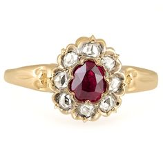 The Elleen Ring from Brilliant Earth circa 1890's This elegant Victorian-era ring is a true antique beauty, showcasing a free-form synthetic ruby with a vivid red hue and a floral halo of rose cut diamonds for a feminine appeal (approx. 0.20 total carat weight).