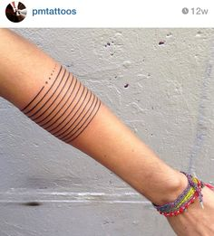 Many lines and dots tattoo