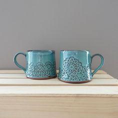 Slab-built mugs with pressed doily pattern in Caribbean Green. #mugshotmonday #pottery #handmadepottery #ceramics #pottersofinstagram #mug #slabbuilt #handbuilt #lacedoily #doily #coffeemug #teacup #simple #etsy #etsyseller #wabisabi #instapottery #insta_pottery #madeinnc #ncmade #madeinnorthcarolina #陶芸 #セラミックス #マグカップ #手作り #ものづくり #ドイリー