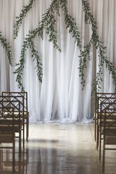 Modern + simple wedding ceremony decor - draped fabric with hanging greenery {epaga FOTO}