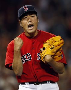 Boston Red Sox closer Koji Uehara celebrates the last out of the ninth inning as the Red Sox defeated the Chicago White Sox 4-3 in a baseball game at Fenway Park in Boston, Friday, Aug. 30, 2013. (AP Photo/Elise Amendola)