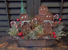 """I placed prim chenille candy canes, faux pine greenery, tiny pine cones and wonderful red berry stems around the gingerbread men. The loaf pan, itself, measures about 10"""" wide by 5"""" deep by 2-1/2"""" tall. 