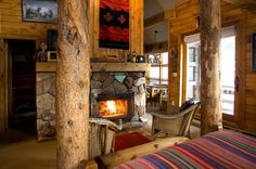 Come home after a day of skiing to a warm fireplace in your cozy cabin at Sundance Resort