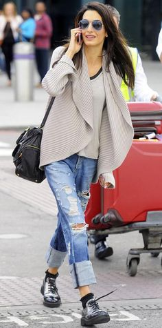 Amal Clooney looking flawless off-duty style in an oversized cardigan, distressed boyfriend jeans, metallic brogues, and aviators.